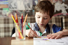 Child drawing with pencils Royalty Free Stock Photos