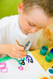 Child drawing picture Stock Images