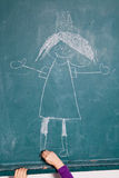 Child drawing picture on chalkboard Royalty Free Stock Images