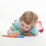Child drawing a picture with colorful felt-tip pens Royalty Free Stock Photography