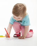 Child drawing a picture with colorful felt-tip pens Royalty Free Stock Images