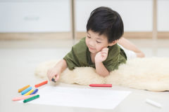 Child drawing picture with crayon Stock Images