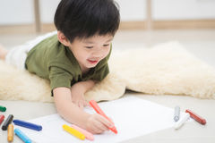 Child drawing picture with crayon Royalty Free Stock Photos