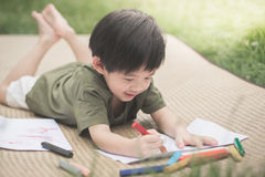 Child drawing picture with crayon Royalty Free Stock Images