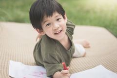 Child drawing picture with crayon Royalty Free Stock Image