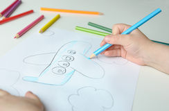 Child drawing a plane Royalty Free Stock Photo
