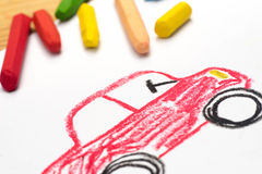 Child drawing, red auto , selective focus. Child crayon drawing, red auto , selective focus royalty free stock images