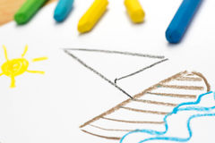 Child drawing, sail boat , selective focus. Child crayon drawing, sail boat, selective focus stock image
