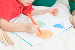 Child drawing shapes. Early education Stock Photography
