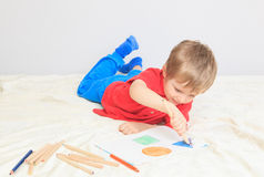 Child drawing shapes. Early education stock photos