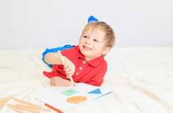 Child drawing shapes Royalty Free Stock Photo