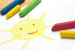 Child drawing, smiling sun , selective focus
