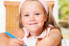 Child drawing something at home Royalty Free Stock Images