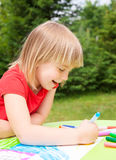 Child drawing in a summer garden Stock Photo