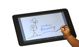 Child drawing on tablet isolated Royalty Free Stock Photos