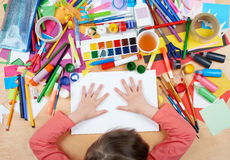 Child drawing top view. Artwork workplace with creative accessories. Flat lay art tools for painting. Stock Images