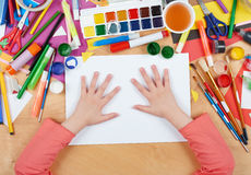 Child drawing top view. Artwork workplace with creative accessories. Flat lay art tools for painting. Child drawing top view. Artwork workplace with creative Royalty Free Stock Images