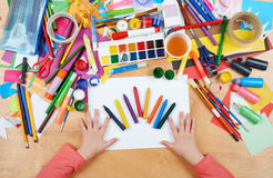 Child drawing top view. Artwork workplace with creative accessories. Flat lay art tools for painting. stock image