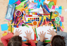 Child drawing top view. Artwork workplace with creative accessories. Flat lay art tools for painting. Royalty Free Stock Image