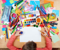 Child drawing top view. Artwork workplace with creative accessories. Flat lay art tools for painting. Royalty Free Stock Photo