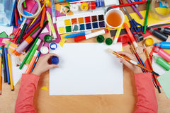 Child drawing top view. Artwork workplace with creative accessories. Flat lay art tools for painting. Royalty Free Stock Photos