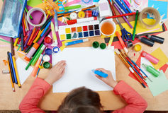 Child drawing top view. Artwork workplace with creative accessories. Flat lay art tools for painting. royalty free stock images