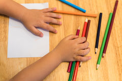 Child drawing by top view Royalty Free Stock Image