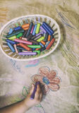 Child drawing with wax crayons over wrapping Royalty Free Stock Photography