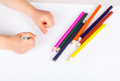 Child drawing. Wirth color pencils Stock Photography