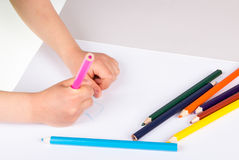 Child drawing. Wirth color pencils Royalty Free Stock Photography