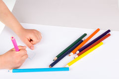 Child drawing. Wirth color pencils Stock Photo