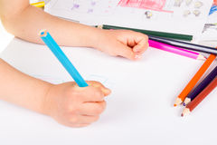 Child drawing. Wirth color pencils Stock Images