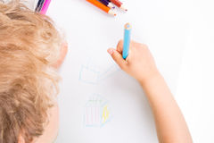 Child drawing. Wirth color pencils Royalty Free Stock Photos