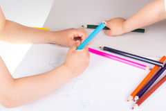 Child drawing. Wirth color pencils Stock Image