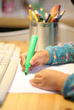 Child drawing and writing Royalty Free Stock Photos