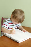Child Drawing or Writing Royalty Free Stock Image