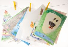 Child drawings. With colored pencils, stacked on table, on wire stock photo