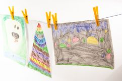 Child drawings. With colored pencils, stacked on table, on wire stock photos