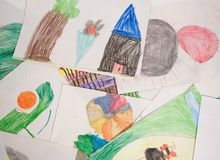 Child drawings. With colored pencils, stacked on table, on wire stock photography