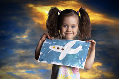 The child with the drawn plane against the sky Stock Photography