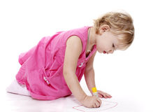 Child draws Royalty Free Stock Image