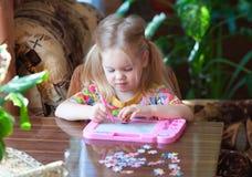 Child draws Royalty Free Stock Photos