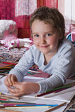 Child draws Royalty Free Stock Image