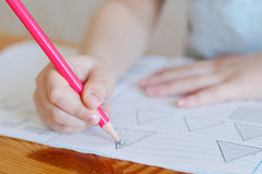 Child draws. In a notebook Royalty Free Stock Photos