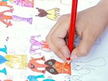 The child draws. A color pencil. The photo is executed by camera Konica Minolta Dimage Z5 Royalty Free Stock Photography