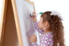 Girl draws on board, indoor Royalty Free Stock Photos