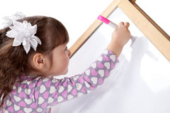 Girl draws on board, indoor Stock Images
