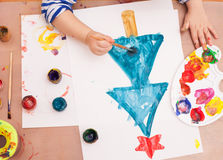 Child draws a brush and paints Stock Photography
