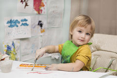The child draws Stock Photography
