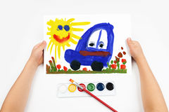 Child draws the car watercolors Royalty Free Stock Images